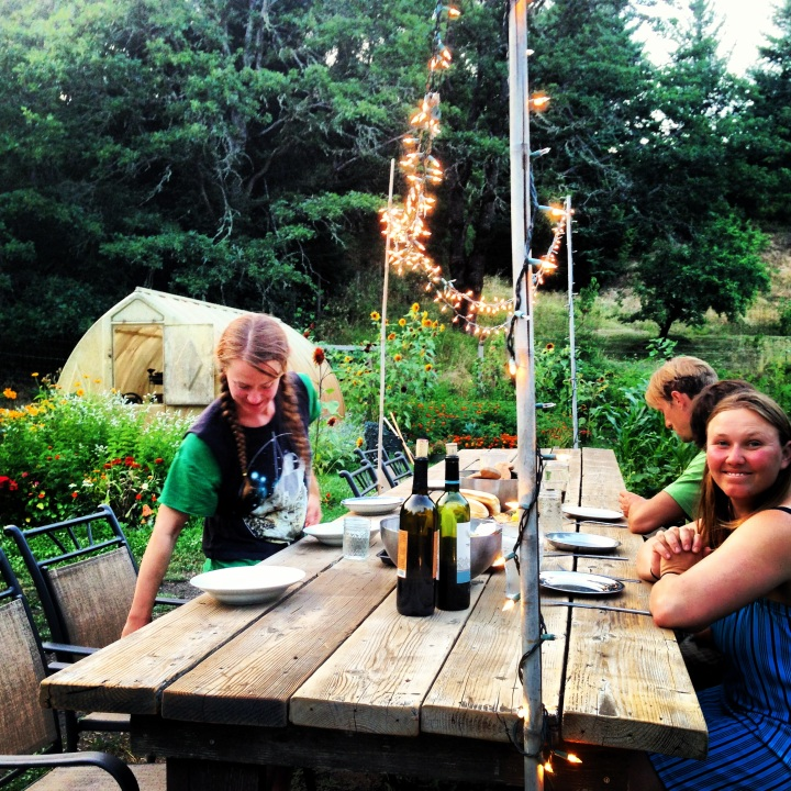 Sitting down to dinner with my friends in Andy's plentiful garden. Pictured: Katie (who helped Clay and I find our way to Hawaii), Deanna, and Andy. New friends in new places.