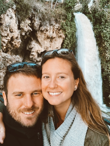 A couple standing in front of Edessa's famous waterfall