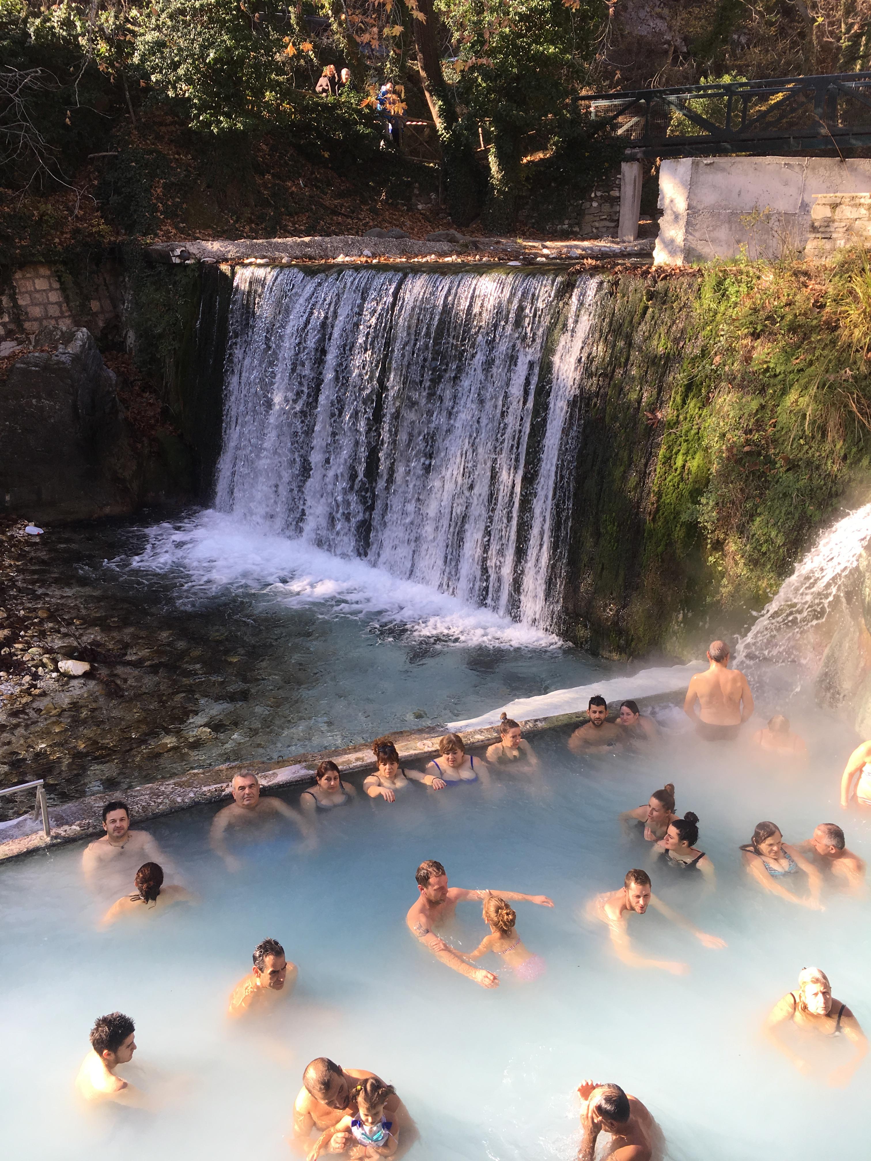 People soaking in natural springs